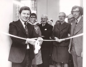 Photograph of Richard Baker cutting a ribbon
