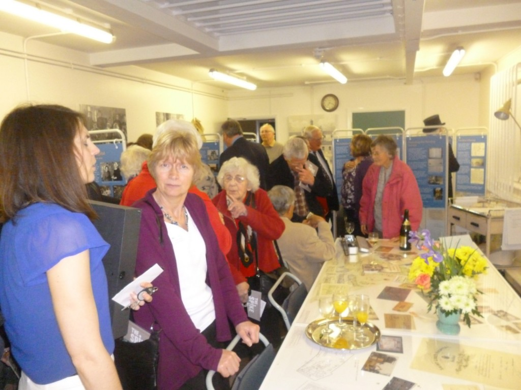 Volunteers and guests at the exhibition